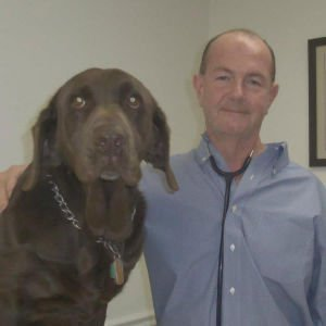"""Dr. McMahon and his 8 year-old Chocolate Labrador named """"Soy"""""""